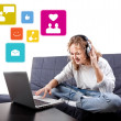 Stock Photo: Beautiful womcommunicate with people by means laptop