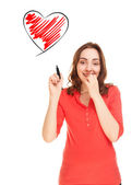 Woman with heart shaped drawing — Stock Photo