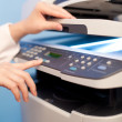 Stock Photo: Woman's hand with copier