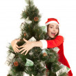 Beautiful smiling woman hugging fir tree — Stock Photo
