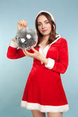 Beautiful woman in new year costume with a silver ball — Stock Photo