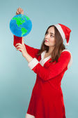 Beautiful woman in new year costume with a globe — Stock Photo