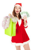 Beautiful woman in new year costume with shopping bag and euros — Stock Photo
