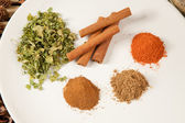 Plate with different spices on the table — Stock Photo