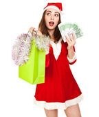 Beautiful woman in red new year costume with a lot of euros — Stock Photo