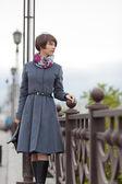 Beautiful young woman walking outdoors — Stock Photo