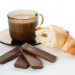 A cup of coffee,  cornetto and a four pieces of chocolate — Stock Photo