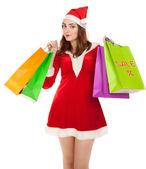 Beautiful woman in new year costume with shopping bags — Stock Photo