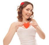 Beautiful woman with valentines card — Stock Photo