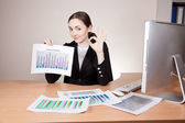 Businesswoman with financial reports — Stock Photo
