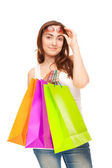 Beautiful woman with colorful shopping bags — Stock Photo