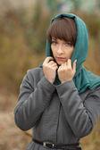 Beautiful woman in grey coat outdoors — Stock Photo