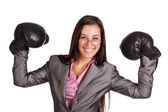 Successful businesswoman in suit and boxing gloves — Stock Photo