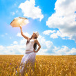 Girl with umbrella is enjoys summer day — Stock Photo