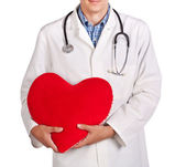 Doctor in a white coat with a red heart — Stock Photo