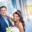 Bride and groom is standing granite wall — Stock Photo