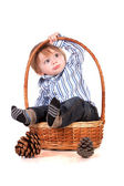 Baby in a basket isolated on a white background — Stock Photo
