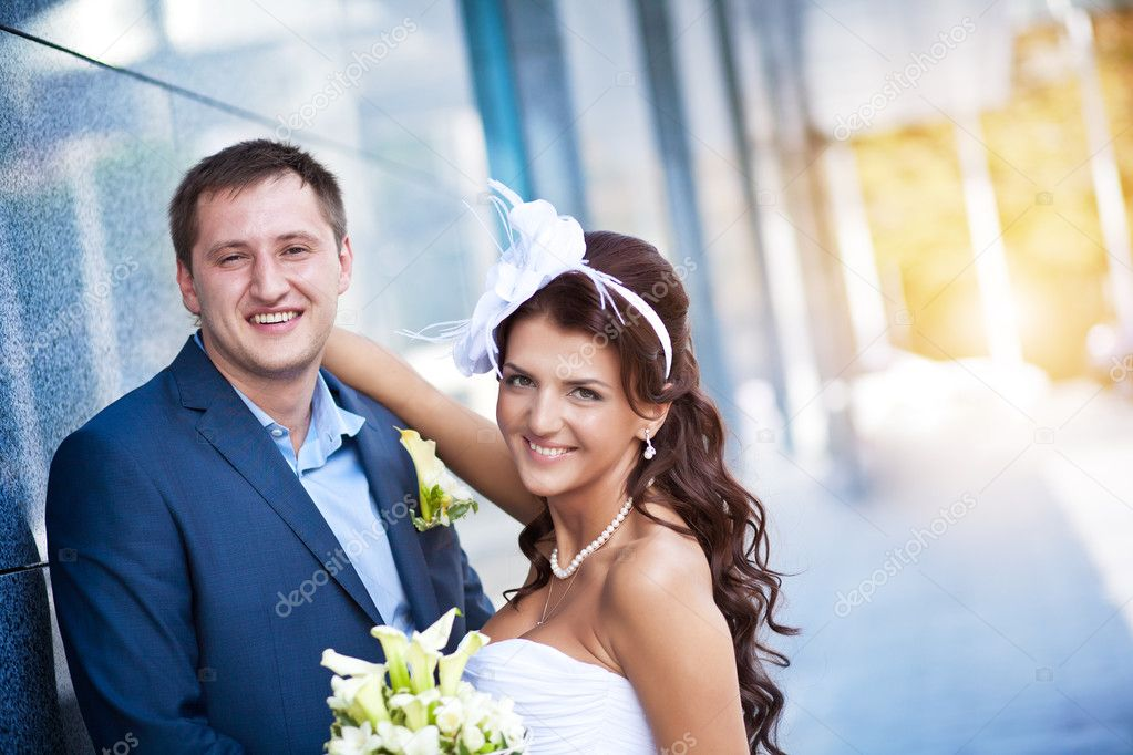 Bride and groom is standing near the granite wall  Stock Photo #12637918