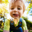 Crying baby in a beautiful summer park — Stock Photo