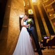 Happy bride and groom in the modern hotel hall — Stock Photo