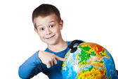 Boy with a globe — Stock Photo