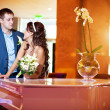 Royalty-Free Stock Photo: Happy bride and groom next to the piano