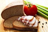 Becon on toast with rad tomato — Stock Photo