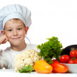 Stock Photo: Cute boy Chef is smiling. isolated