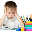 Sad schoolboy doing is homework — Stock Photo #13341149