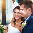 Happy bride and groom in a bright room — Stock Photo