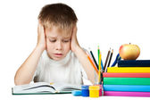 Smutný kluk dělá je domácí úkol — Stock fotografie