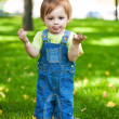 Happy baby resting on the green grass — Stock Photo