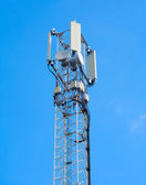 Telecommunications tower on a blue sky — Stock Photo