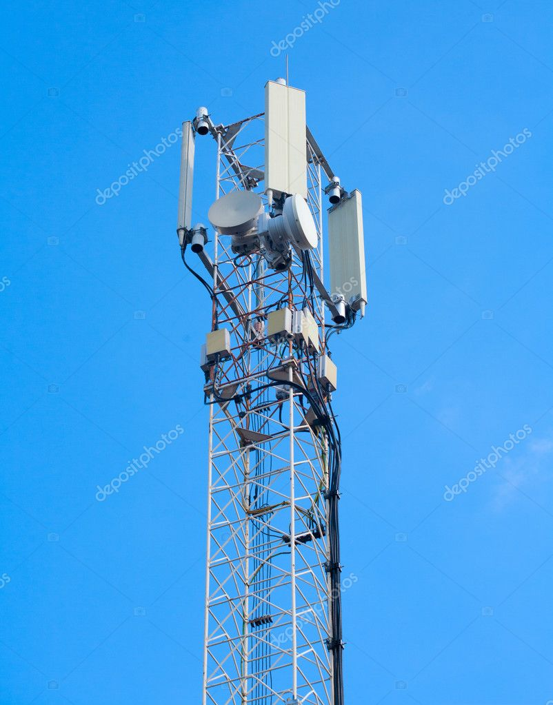 Telecommunications tower on a blue morning sky  Stock Photo #13466988