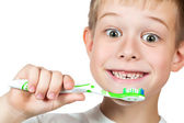 Cheerful boy is brushing his teeth isolated — Stock Photo