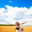 Happy couple in the field of wheat with blue sky — Stock Photo
