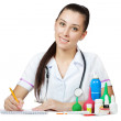 Woman doctor is writing a prescription — Stock Photo