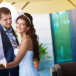 Bride and groom is hugging near the window — Stockfoto