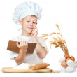 Chef boy is reading a recipe cook — Stock Photo