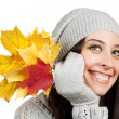 Cheerful girl with yellow autumn leafs. isolated — Stock Photo