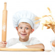 Little scullion is kneading dough — Stock Photo