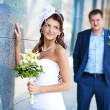 Bride and groom is standing near the granite wall — Stock Photo #13875390