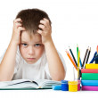 Sad schoolboy is doing his homework — Stock Photo #14067296