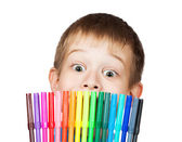 Cheerful boy with a felt-tip pen before his face — Stock Photo