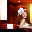 Happy bride is sitting in a bright room — Stock Photo #14076045