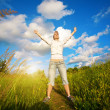 Royalty-Free Stock Photo: Happy girl over the blue sky