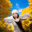 Happy woman on a autumn sky background — Stock Photo
