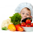 Cute chef boy is hiding behind a vegetables. isolated — Foto Stock