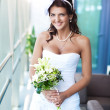 Happy bride with wedding bouquet — Foto de stock #14329533