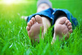 Feet on grass. Family picnic in spring park — Stock Photo